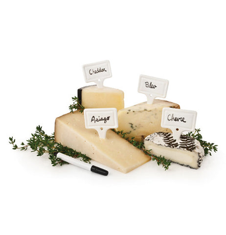 White markers in use on various cheese.