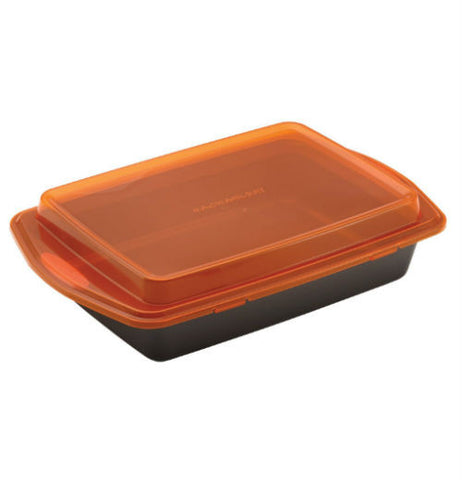 A gray baking dish with an orange lid snapped onto it.