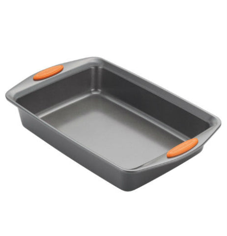A gray baking dish with small orange rubber pads on the handles.