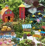 a miniature fairy farm with a barn and a ferris wheel and animals and with other farm buildings.