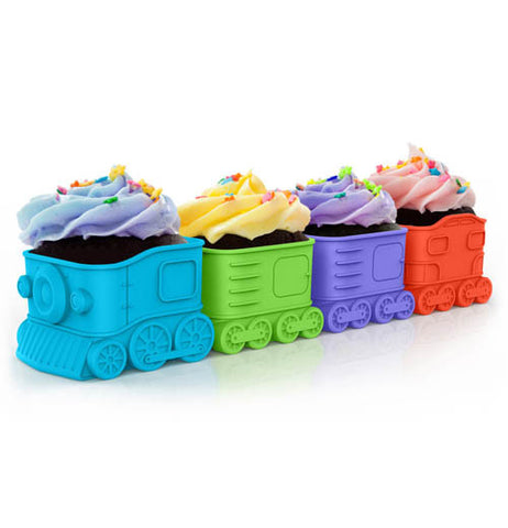 These are cupcake holders shaped like a train. The blue holder is shaped like a locomotive, and the green, purple, and red holders behind the locomotive are shaped like boxcars.