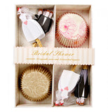 Wedding themed pink and gold cupcake liners with bride and groom toppers