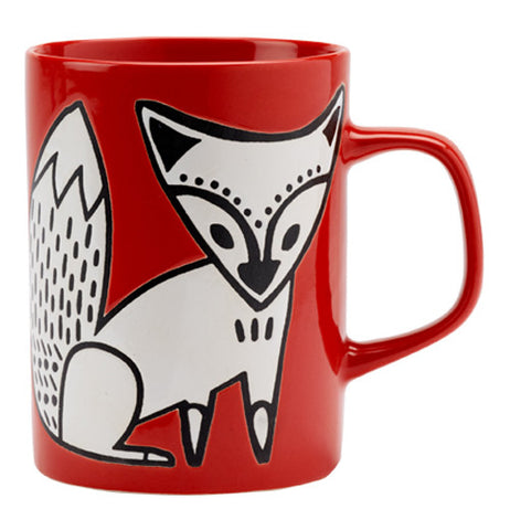 This red ceramic mug has a white fox design on it.