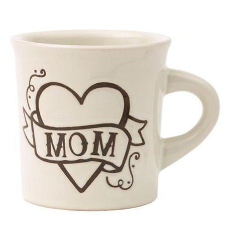 The white mug has a heart with mom written on a ribbon wrapped around the heart