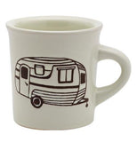 This is a diner inspired ceramic mug featuring a travel trailer design.