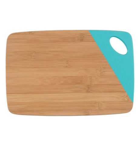 Wooden rectangular cutting board with a turquoise dipped edge on the upper right side where a hole thats used as a handle is.