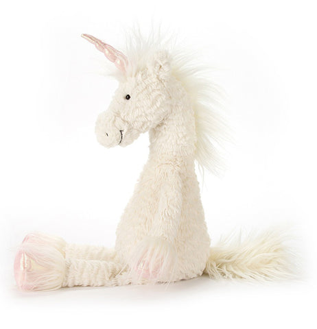 A left side view of a Dainty Unicorn has a smile on its face.