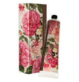 Shea butter lotion with floral flowers illustrated beautifully on it. The lotion is placed next to it's box.