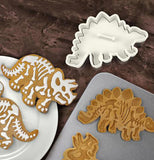 Dinosaur shaped cookie cutter and the cookies made from them.