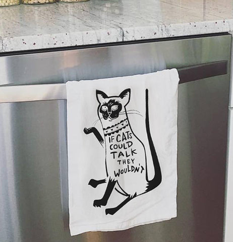 Cat dish towel hanging on the oven door.