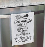 Grammy's kitchen dish towel hanging on the oven door.