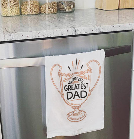 World's greatest dad dish towel hanging over the oven door.