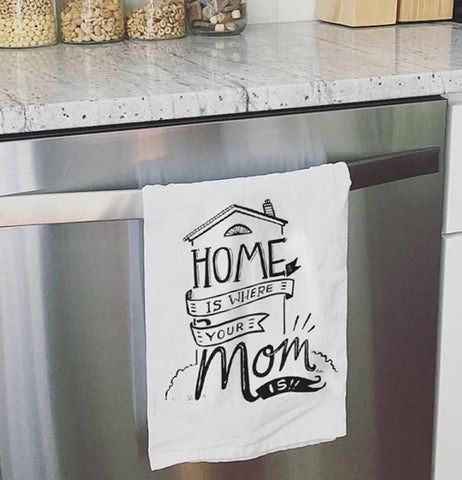Home is where your mom is dish towel hanging over a oven door.
