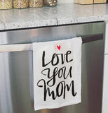 Love you mom dish towel hanging on the oven door.