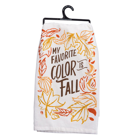 "White towel with the outline of leaves in gold and orange glitter surrounding the words ""my favorite color is fall"" written in brown."