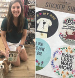 This sticker sheet is dog themed that contain stickers that have some wording on them and each of them has a different design with a woman to the left holding one package with her dog.