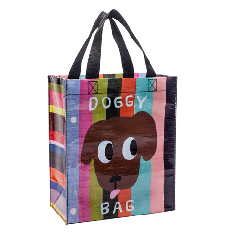 "The ""Doggy Bag"" Handy Tote bag shows a picture of a brown dog's face with his tongue sticking out on a colored striped background"