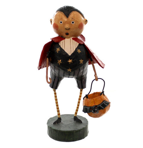 This figurine wears a red cape and a black Dracula costume holding a pumpkin shaped halloween candy bucket with a bat on it.