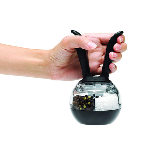 This Duel Pepper ball salt and pepper shaker has an easy to carry handle with a glass bottom. with salt and pepper in the shaker.