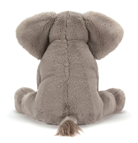 "The Little ""Emile Elephant"" sits on the back with his back ears and tail."