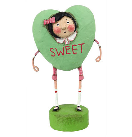 Resin figurine of a girl dressed in a green heart costume that says sweet.
