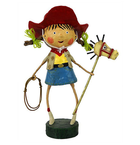 This cowgirl figurine has a red hat, yellow shirt, and a blue skirt. She is holding a stick horse in one hand and a rope in the other hand.
