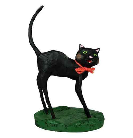 This figurine is of a black cat with a red bow tie around its neck.