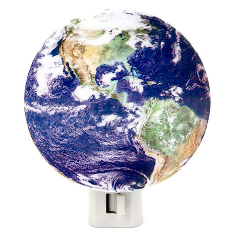 This night light is shaped to look like the earth, showing the North and South American continents.