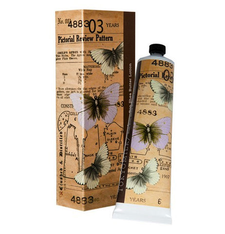 Tan packaging with a butterfly design on both the box and the tube