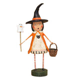This young witch figurine holds a ghost wand while carrying a wicker basket.
