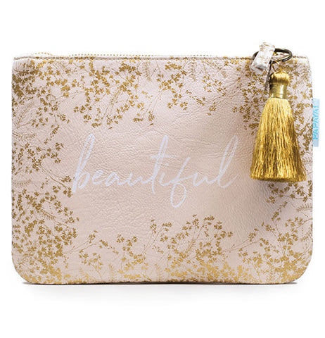 "Gold floral pouch with a white zipper and a gold tassel and has the word ""Beautiful"" written in the middle."