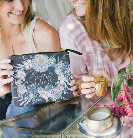 "Two women sharing the ""Seeds"" Pocket Clutch."