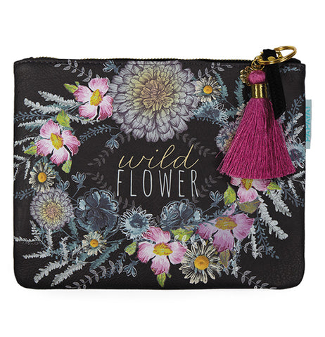 "The ""Seeds"" Pocket Clutch features flowers on a black background surrounding words that reads, ""Wild Flower"" in gold and white letters."