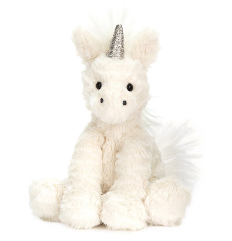 This white stuffed unicorn toy features a bright white mane, a short bright white tail, and a silver horn sticking out from its forehead.