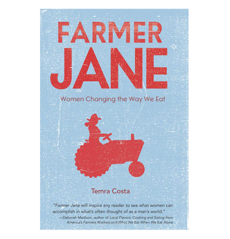 "This book cover has ""Farmer Jane Women Changing the Way We Eat"" printed on it in red lettering. The woman on the tractor is red as well, while the background is light blue."