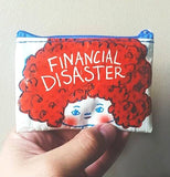 "A hand holds the ""Financial Disaster"" Coin Purse."