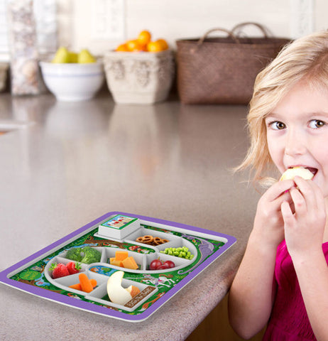 Purple game board plate with different types of food in each slot and a girl to the side eating one of its may treats.