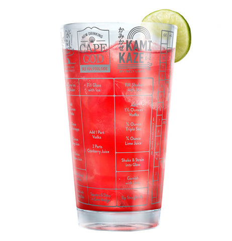Vodka drink cup filled with a red drink and a lemon or lime on the rim.