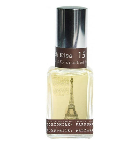 perfume is in a clear bottle with the Eiffel tower and brown edges.