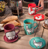 The teal llama mug and coaster are shown next to two red cups and coasters, one with a hedgehog design, the other with a fox design.