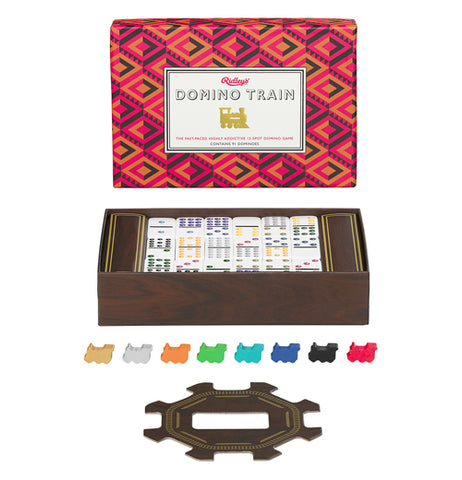 This game of dominoes has a vibrant pink, purple, and green box lid made up of optical illusion-like pattern with a brown and gold bottom box with the dominos in it and the other pieces in front.