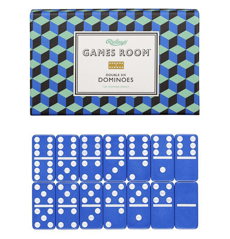 "Set of blue and white dominoes placed together in front of green and blue box that reads ""Games Room Double Six Dominoes"" in black and white words."