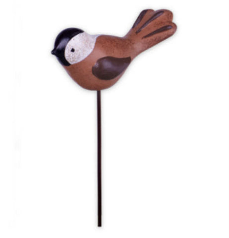 Miniture garden songbird stake brown,and black, with a white head.