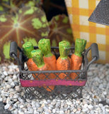 "The ""Carrot Basket"" is in a garden decoration outside."
