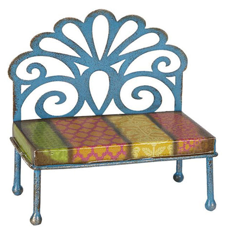 "The mini ""Filigree Patterned Bench"" has a filigreed back with a bench with 4 multicolored patterns; the colors include green, orange, and yellow."