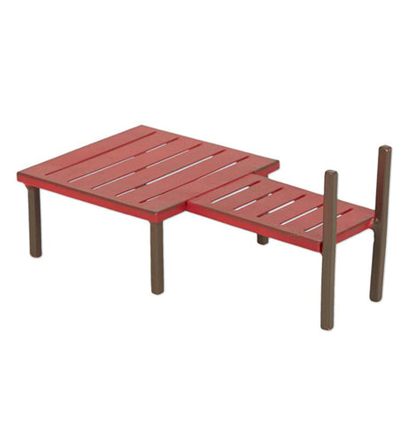 This sculpture is of a small boat dock with red slats and some brown pilings.