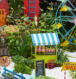 "The Mini ""Fair Fun"" Sign sits with the other miniature fair sets outside the garden."