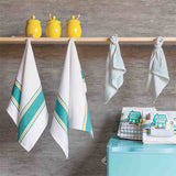 The teal set of 4 dishtowels (two big ones that are white with teal large and small stripes along the top and bottom, and two small ones that are white with dashed stripes) hanging up that displays what it looks like to have them in your home.