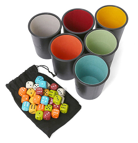 The dice are all lying on top of their bag with the cups standing beside them.