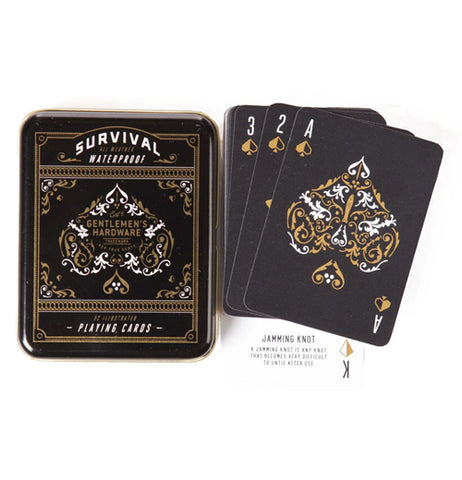 The black playing cards are shown outside lying next to their box against a white background.
